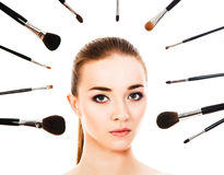 Beautiful woman with cosmetic brushes isolated. Beautiful woman with cosmetic brushes Stock Photo