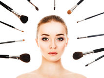 Beautiful woman with cosmetic brushes isolated. Beautiful woman with cosmetic brushes Royalty Free Stock Photography