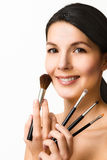 Beautiful woman with cosmetic brushes Royalty Free Stock Photography