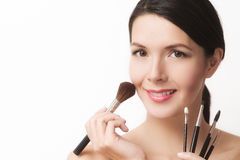 Beautiful woman with cosmetic brushes stock images