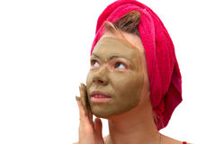 Beautiful woman with cosmetic mask Royalty Free Stock Photo