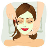 Beautiful woman with cosmetic mask on face Stock Image
