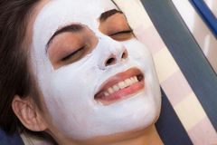 Beautiful Woman With Cosmetic Mask on Face Stock Images