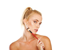 Beautiful woman with cosmetics brush Stock Images