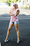 The beautiful woman costs on the tennis court Royalty Free Stock Photography