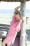 The beautiful woman costs in a wooden arbor. A subject sea tour Royalty Free Stock Photo