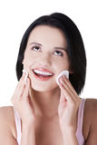 Beautiful woman with cotton pad Royalty Free Stock Image