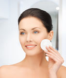 Beautiful woman with cotton pad Royalty Free Stock Photography