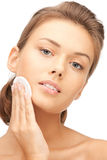 Beautiful woman with cotton pad Royalty Free Stock Images