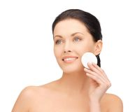 Beautiful woman with cotton pad Stock Images