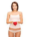 Beautiful woman in cotton underwear and red heart Royalty Free Stock Photography