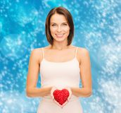 Beautiful woman in cotton underwear and red heart. Health, charity and beauty concept - beautiful woman in cotton underwear showing red heart royalty free stock image