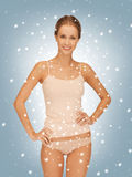 Beautiful woman in cotton undrewear with snow. Picture of beautiful woman in cotton undrewear with snow royalty free stock images