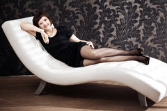 Beautiful woman on the couch Royalty Free Stock Image