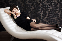 Beautiful woman on the couch Stock Image