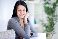 Beautiful woman on couch Royalty Free Stock Image