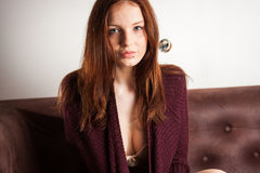 Beautiful woman on the couch Stock Photos