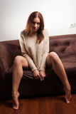 Beautiful woman on the couch Royalty Free Stock Images