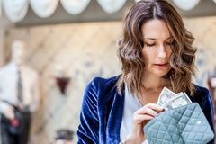 Beautiful woman counting cash in her wallet. Shopping, payment, accounting, audit, money. Close-up stock images