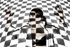 Beautiful woman covered with black and white squares Stock Images