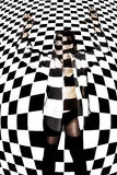 Beautiful woman covered with black and white squares Stock Photo