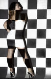 Beautiful woman covered with black and white squares Royalty Free Stock Image