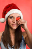 Beautiful woman covered eye by red heart Stock Photos