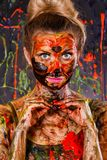 Beautiful woman covered with multicolored paints Stock Photography