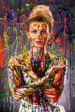 Beautiful woman covered with multicolored paints Stock Photos