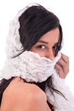 Beautiful woman covering face with handkerchief Stock Images