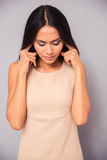 Beautiful woman covering her ears with fingers Royalty Free Stock Photos