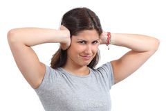 Beautiful woman covering her ears with her hands. Isolated on a white background Royalty Free Stock Images