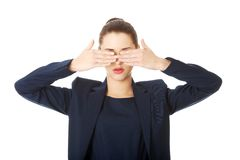 Beautiful woman covering her eyes Stock Image