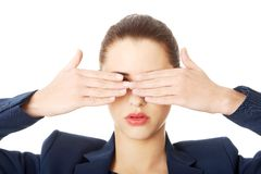 Beautiful woman covering her eyes Stock Images