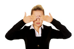 Beautiful woman covering her eyes with her hands. Stock Image