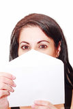Beautiful woman covering her face with a letter is Royalty Free Stock Photos