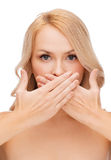 Beautiful woman covering her mouth Royalty Free Stock Photos
