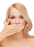 Beautiful woman covering her mouth Royalty Free Stock Images