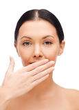 Beautiful woman covering her mouth. Spa, health and beauty concept - beautiful woman covering her mouth Stock Photography