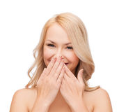 Beautiful woman covering her mouth Stock Image