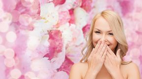 Beautiful woman covering her mouth Stock Photos
