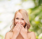 Beautiful woman covering her mouth Stock Photo