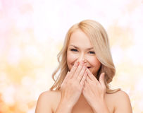Beautiful woman covering her mouth Royalty Free Stock Photo