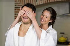 Beautiful woman covering mans eyes Royalty Free Stock Images