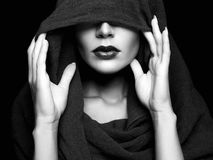 Beautiful woman in hood. Black and white portrait stock image