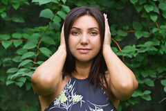 Beautiful woman covers her hands over her ears Royalty Free Stock Photos