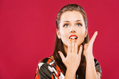 Beautiful woman covers mouth Stock Image