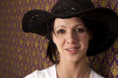 Beautiful woman with a cowboy hat Stock Photography