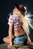 Beautiful woman in cowboy hat. Beautiful sexy woman in cowboy hat Royalty Free Stock Image