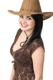 A beautiful woman in a cowboy hat. The natural portrait of a young attractive brunette on white background Royalty Free Stock Image